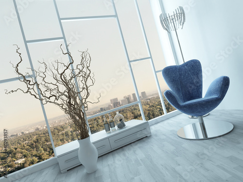 Stylish blue armchair in a modern white room