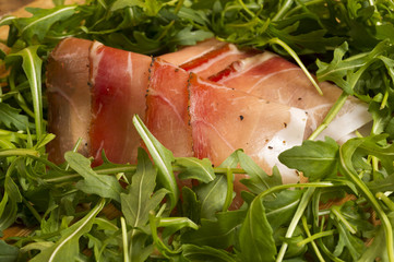 european ham called speck with green salad