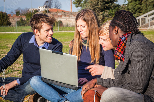 College Students with Computer at Park