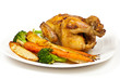 Whole roasted chicken and various vegetables