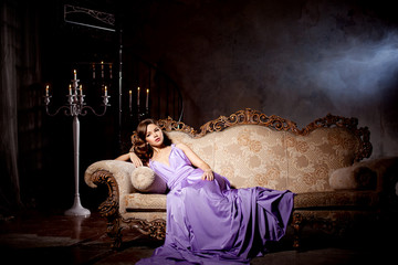 Luxury fashion stylish woman in the rich interior. Beauty girl w
