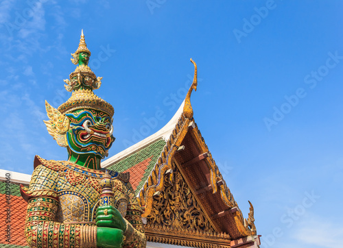 Green Demon  Guardian Statue against Blue sky Background