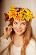 Beauty autumn woman smiling on the porch of yellow and orange au