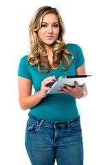 Teen girl using tablet pc