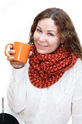 Beautiful girl in bright scarf with cup coffee in hand, isolated