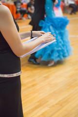 female judge in a dancing match