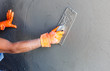 plasterer concrete worker at wall of house construction - 60303003