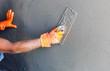 Leinwanddruck Bild - plasterer concrete worker at wall of house construction