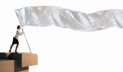 Businesswoman holding white flag
