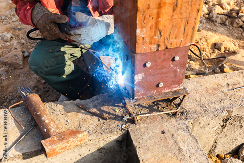 welding metal and wood by electrode with bright electric arc