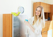 Positive  housewife cleaning  glass