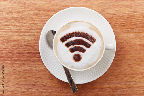 Free wifi area sign on a latte coffee