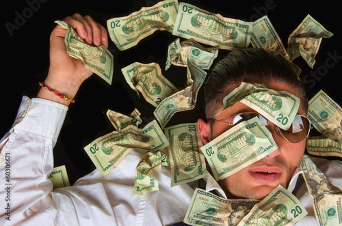 Business man on the floor covered with dollars