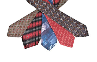 Five varicoloured neckties isolated on white background.
