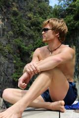 Sexy man sitting
