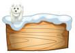 A white polar bear above the wooden signboard