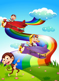 A sky with a rainbow and planes with monkeys