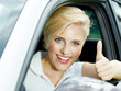 Woman shows thumbs up in her new car