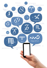 Hand holding smartphone with online astrology site template