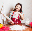 beautiful girl cooking cake in kitchen