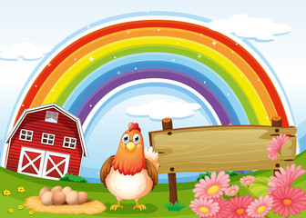 A hen at the farm with a rainbow and an empty signboard