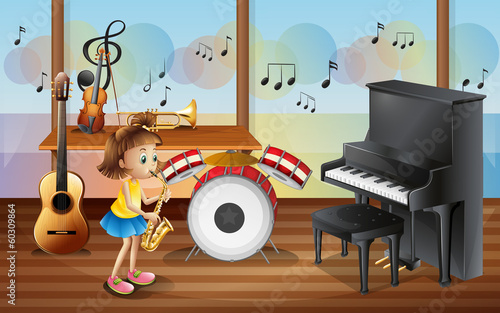 A young girl surrounded with musical instruments