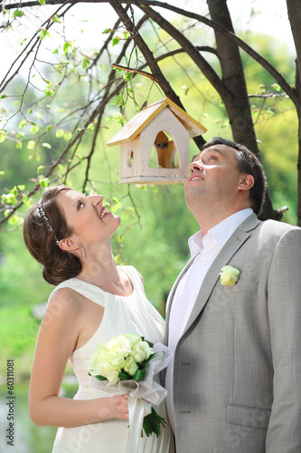 Beautiful bride and groom near the tree