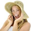 Frau mit Stroh-Hut lacht laut