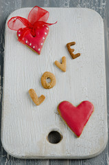 Heart shaped valentine cookies on a wooden board
