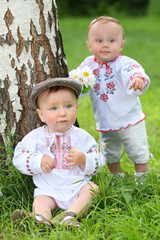 Little boy and girl in russian folk costumes