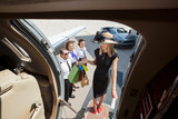 Rich Woman With Shopping Bags Boarding Private Jet