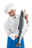 Chef cook holding a big atlantic salmon fish