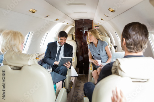 Business People Working In Private Jet - 60312881