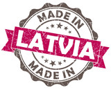 made in latvia pink grunge seal isolated on white background