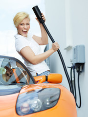 Woman loading electrically powered car