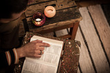 Reading Holy Bible on vintage table