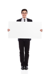 Young male office worker standing with placard.