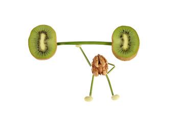 Healthy eating. Funny little people of the walnut raises kiwi ba