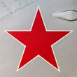 Detail of an old Russian jet fighter with a red star
