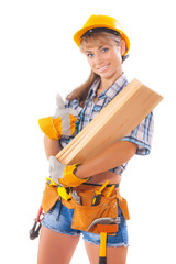 Portrait of young female construction worker carrying wooden boa