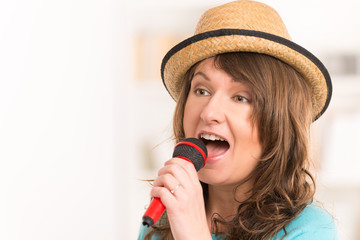 Woman singing with a microphone