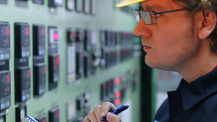 Engineer with glasses in a control room at the factory