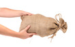 Hands hold full bag with money.