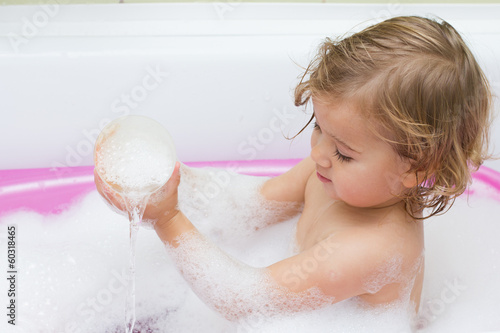 Little girl playing in the bath