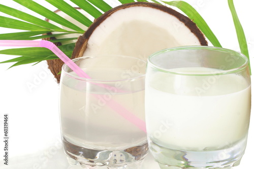 coconut water and coconut milk with cut coconut and leaves