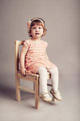 little unhappy girl studio portrait.
