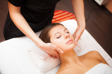 Woman enjoying a facial massage