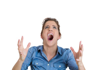 Closeup portrait of angry upset young mad woman screaming