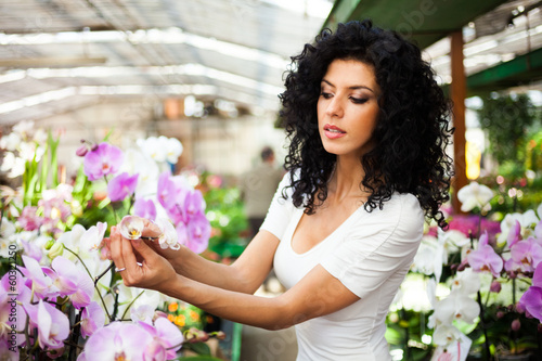 Woman looking to orchids