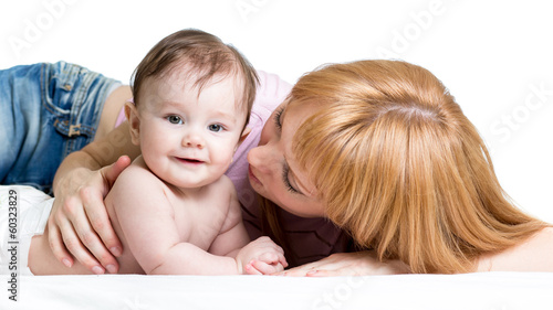 mother playing with baby girl isolated on white